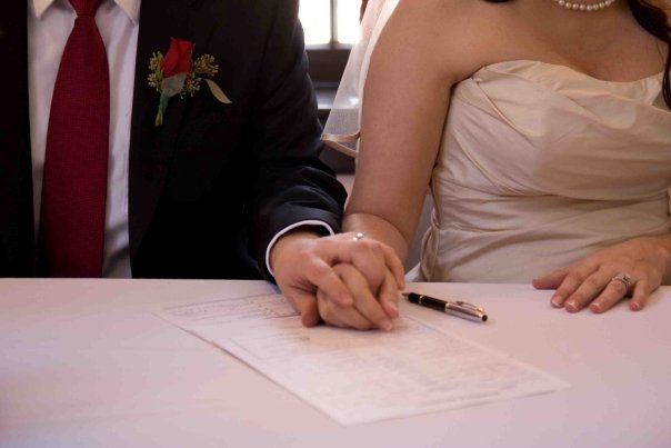 Couple Signing  Marriage License, L.A. County Marriage License Services, Mobile Marriage License and Officiant Services